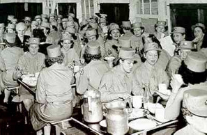 Dr. Minne Maffett, 1939/44 BPW/USA President shares mess with the Station Complement WAC Detachment at Camp Crowder, Missouri.