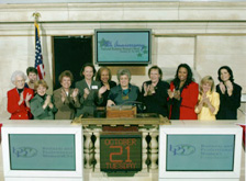 Those ringing the bell include BPW/USA President Carolyn Grady, BPW Foundation Chair Pat Cornish, BPW Foundation Vice-Chair Avis Parman, BPW/USA Vice President Roslyn Ridgeway, BPW/USA Secretary Janie Smith, BPW/USA Individual Development Chair Maria Hernandez, BPW/USA and BPW Foundation CEO Jane Smith, BPW/USA meeting planner Tricia Fadness, and BPW supporters Wyndham Hotels & Resorts Treasurer, Judy Hendrick and Ernst & Young partner, Barbara Raasch.
